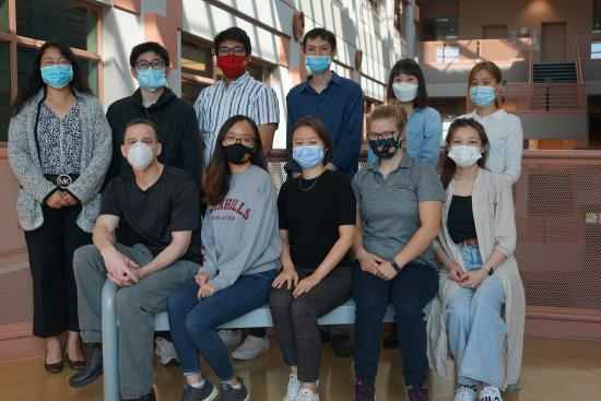 Dr. Hua Bai (standing, fourth from left) and the Bai Lab research group